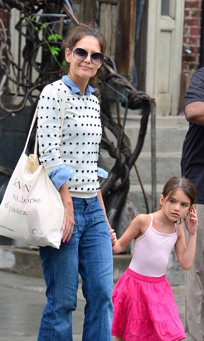 "KATIE HOLMES: On daughter Suri Cruise's fashion sense: ""She'll really tell me [what she thinks]. Like today I'm wearing brown suede pants, and she said, 'I don't like your pants.' But then she'll say, 'You've got to wear these shoes' or 'That's so pretty, Mum. Wear that.' She's got a great eye."" (Elle)"