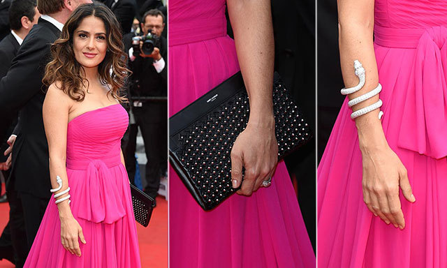 Salma Hayek added sparkle to magenta gown with a diamond-encrusted Boucheron snake cuff.