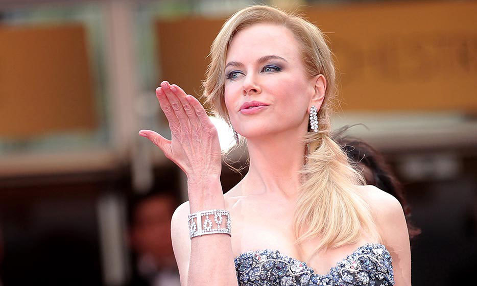Nicole Kidman looked like royalty at the premiere of 'Grace of Monaco' thanks to her regal Harry Winston earrings and a diamond cuff bracelet to match.