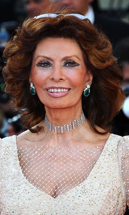 Screen legend Sophia Loren made her green eyes pop with a pair of enormous emerald drop earrings.