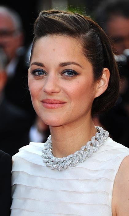 Marion Cotillard added weight to her floaty white Dior dress with an oversized Chopard chain necklace and chunky heels at the premiere of 'Two Days, One Night.'