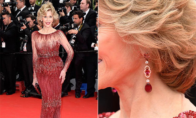 Jane Fonda dazzled in delicate red-and-gold Chopard earrings and added a ruby-red Gucci bag to coordinate with her Elie Saab dress.