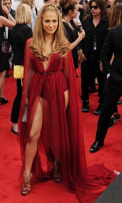 Leave it to Jennifer Lopez to heat up a red carpet with a pair of legs that are clearly fit as a fiddle, especially in this Donna Karan gown at the 2014 Billboard Music Awards.