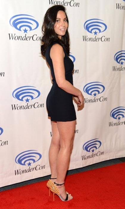 Forget everthing you've ever heard about fandom conventions, because Olivia Munn and her short jumpsuit brought the sizzle to Anaheim's 2014 WonderCon. One look at the 'Deliver Us From Evil' star and you know those legs are made for walking.