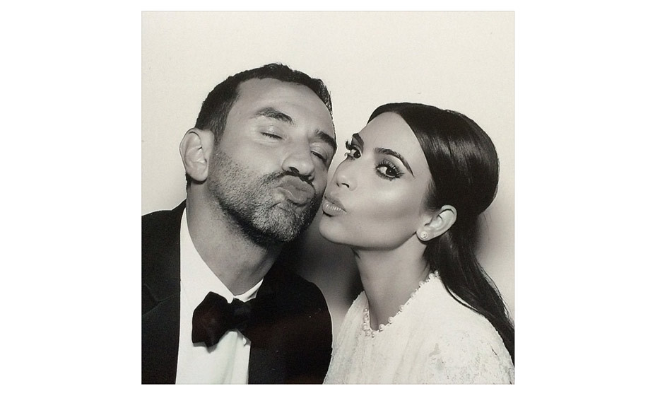 Kim makes a kissy kissy face with Ricardo Tisci, who designed her Givenchy wedding dress. Photo: Instagram