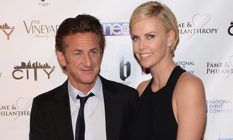 Sean Penn and Charlize Theron at the Fame and Philanthropy post-Oscar Party benefiting The Community Inspiring Today's Youth in March 2014. (Photo: Amanda Edwards, WireImage)
