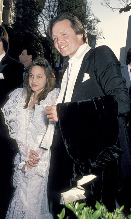 Attending the Academy Awards with her father Jon Voight in March 1986