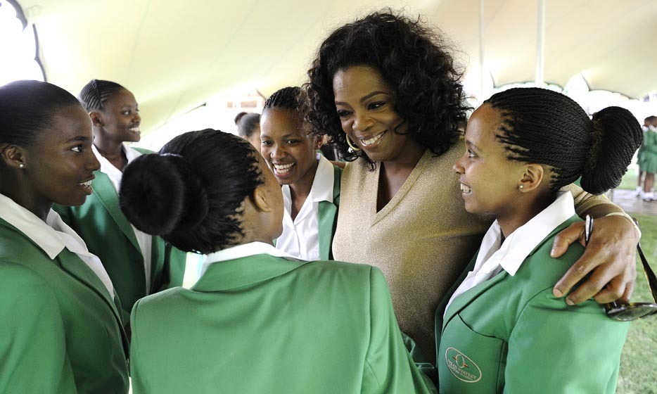OPRAH WINFREY: One of the world's most generous celebrities, Oprah Winfrey is not one to do anything half-heartedly. The media mogul founded and funded her own boarding school, the Leadership Academy for Girls, in 2007, with the goal of providing an education for gifted girls from impoverished backgrounds. Photo: © STEPHANE DE SAKUTIN/AFP/Getty Images