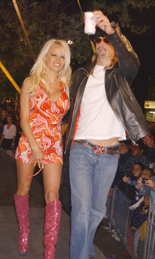 A ROCKY BEGINNING: In 2002, Pamela Anderson and Kid Rock made one of their first public appearances as a couple at the Canadian awards show. The pair dated for a year until they split in 2003, rekindling their rocky romance to finally wed in 2006 – and divorce four months later.