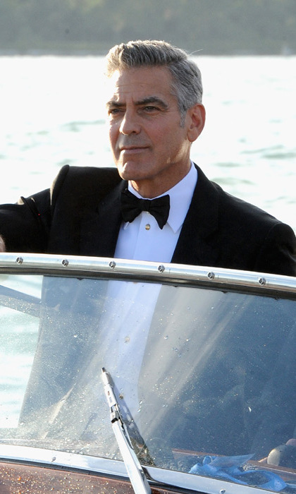 George pictured at the wheel of a speed boat in Venice last year. Photo: © Getty Images