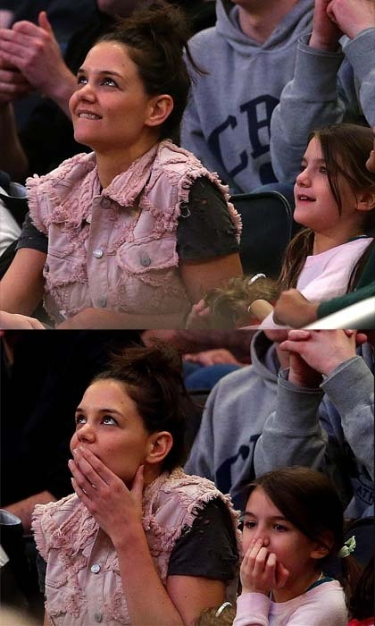 Suri Cruise and mom Katie Holmes couldn't be closer if they tried. They spend tons of time together but the pair also has the same effortless brown hair, long and lean frame, and petite features. Even here at the NCAA East Regional Finals in 2014, Suri couldn't help but emulate her famous mom. Photo: © Getty