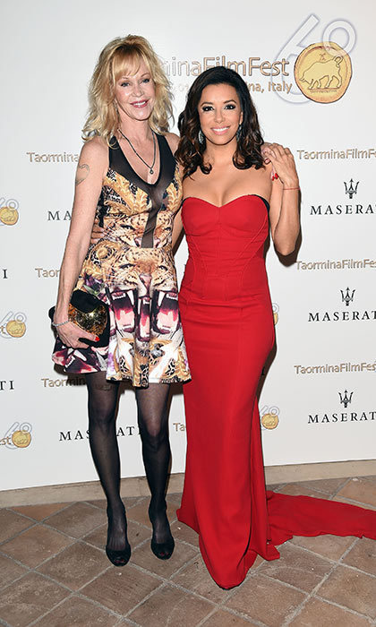 Melanie posing with good friend Eva Longoria.