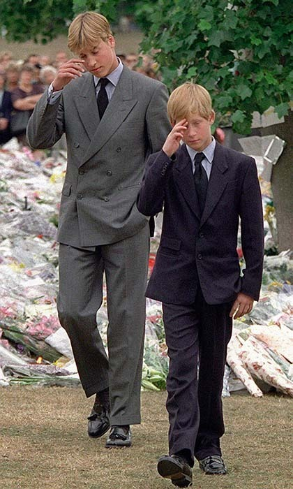 An emotional Prince William and Prince Harry gestured after they arrived at Kensington Palace to view some of the flowers and mementos left in memory of their late mother, Princess Diana. Her funeral was the following day at Westminster Abbey.
