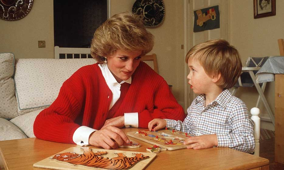 With a twinkle in her eye, Princess Diana helped the inquisitive Prince put together a jigsaw puzzle in his playroom.