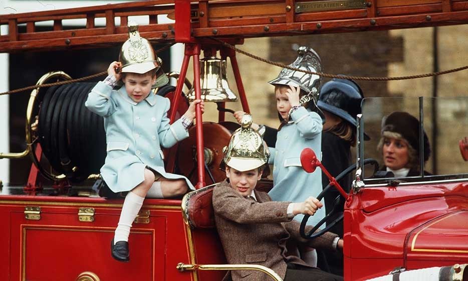 Prince William, Prince Harry and their cousin, Peter Phillips, were spotted playing on a fire engine at Sandringham.