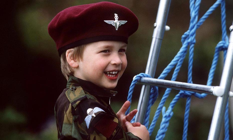 The future pilot put on his miniature parachute regiment uniform for some playtime in the gardens at Highgrow House.