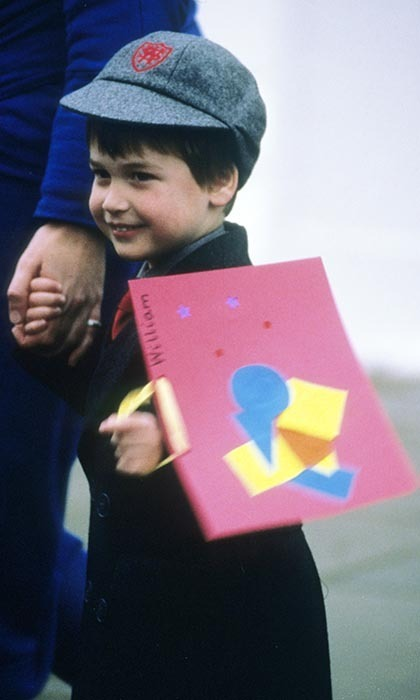 Coming home from his first day at Wetherby School in London, Prince William looked delighted as he carried his workbook home.