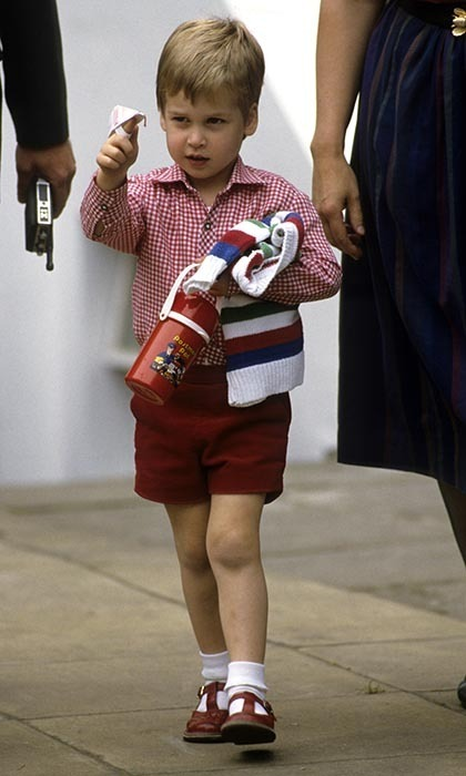 The playful Prince showed off his handmade finger puppet as he left his first day at nursery school in 1985.