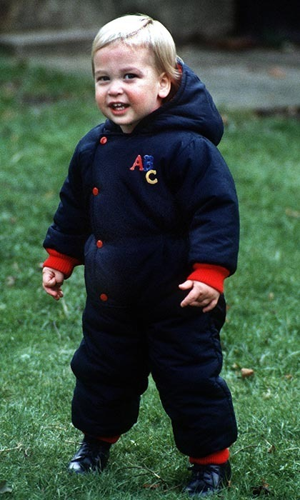 For his first official photocall in the Kensington Palace gardens, the Prince was too cute in his navy-blue outfit with red buttons.