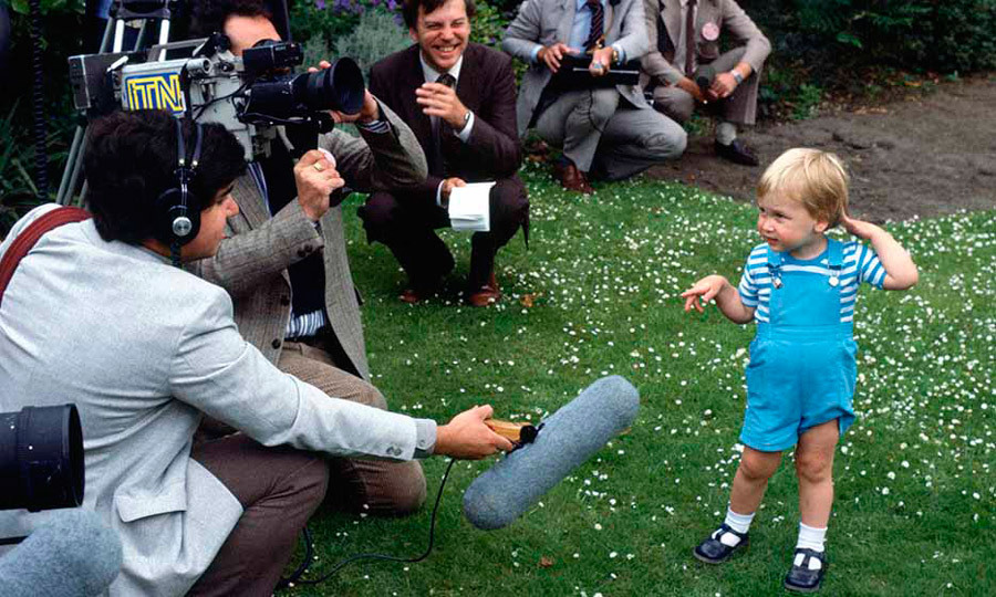 He was already a media darling at his second birthday party, where William charmed reporters with his grown-up poses.