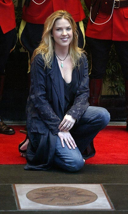 Jazz pianist and singer Diana Krall has sold more than 15 million records worldwide. Here, she's seen posing after unveiling her star on Canada's Walk of Fame in Toronto. Photo: © Getty