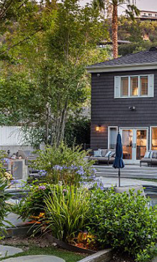 The backyard is beautifully landscaped and fit for youthful frolicking. (Image: Brandon Vogts)