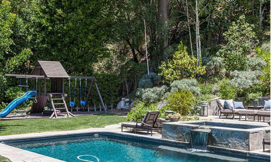 A backyard fit for a family. A playground, pool and lounge area ensure there is something for every member of the family. (Image: Brandon Vogts)