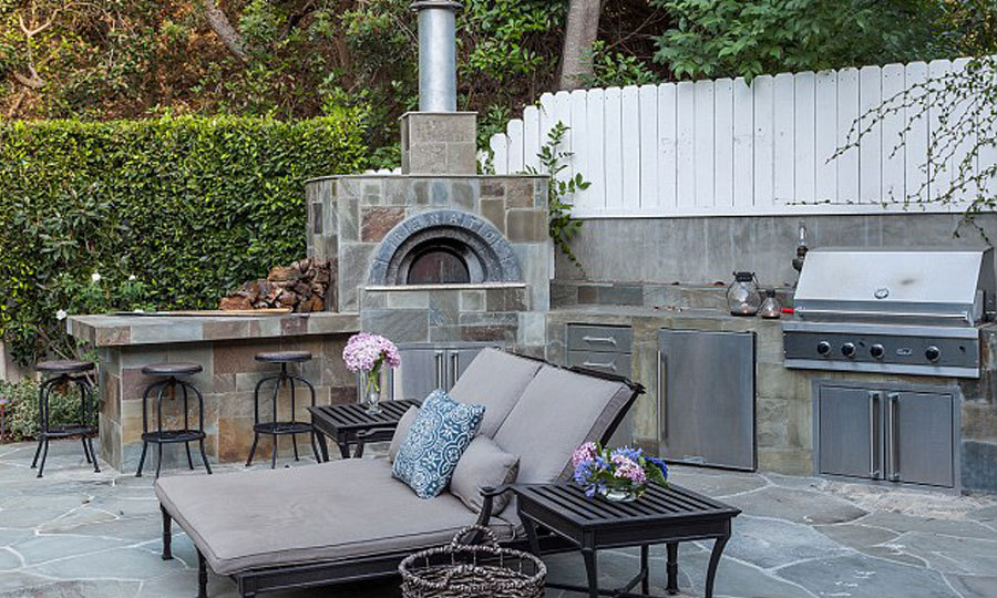 Wood oven pizza can be made on the premises. Why would you ever deliver with this in your backyard? (Image: Brandon Vogts)