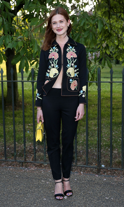Bonnie Wright went shirtless for London's Serpentine Gallery event in just a vintage embroidered jacket and black trousers, paired with a sunny box bag and black sandals