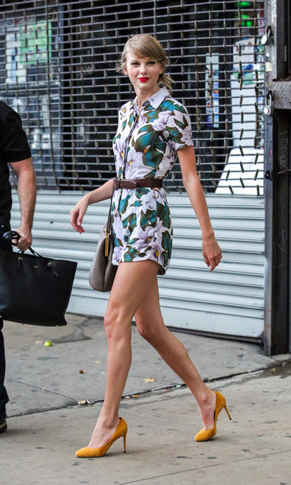 Taylor Swift was the embodiment of summer style as she left a NYC gym in a colourful Topshop romper and mustard Gucci pumps. The songstress accentuated her slim waist with a basic belt and, as always, finished her look with a classic red lip