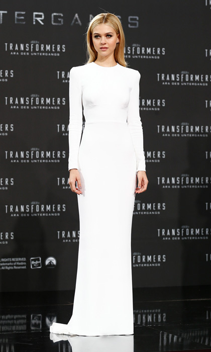Newcomer Nicola Peltz hit it out of the park at the Berlin red carpet premiere of 'Transformers: Age of Distinction' in a backless column gown by Stella McCartney