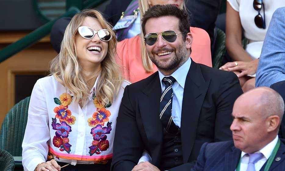 Bradley Cooper could hardly keep his eyes on the ball with his beautiful fiancée Suki Waterhouse by his side!