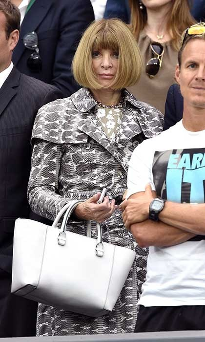 Anna Wintour made a rather stylish appearance at the Eugenie vs. Petra match sporting a python-printed trench coat.
