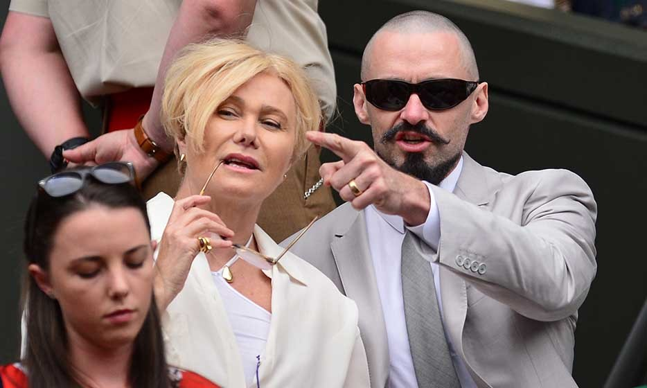 An almost unrecognizable Hugh Jackman showed up for the men's final sporting a shaved head and vintage facial hair. His wife Deborra-Lee Furness chose a more classic, all-white look.
