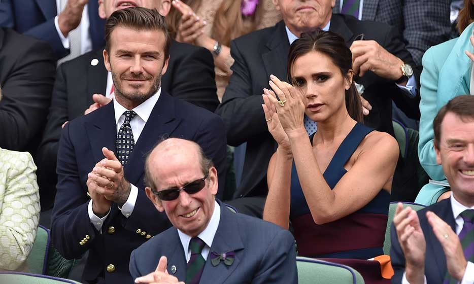 Wearing coordinating navy outfits, David and Victoria Beckham sat behind Prince Michael of Kent in the Royal Box as they attended the men's final.