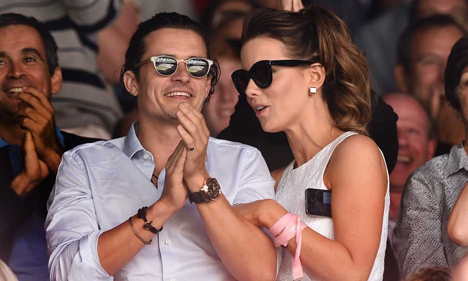 Orlando Bloom and Kate Beckinsale looked riveted at the men's final game — they hardly sat down!