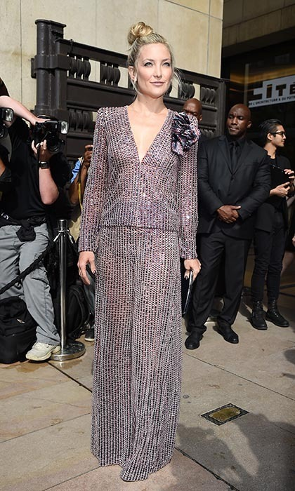 Hollywood's resident hippie, Kate Hudson, stepped out at Armani Privé's fall show in a shimmering purple jumpsuit during Haute Couture Fashion Week. Taking the topknot a step further with off-kilter styling, Kate accessorized with a super thin clutch.