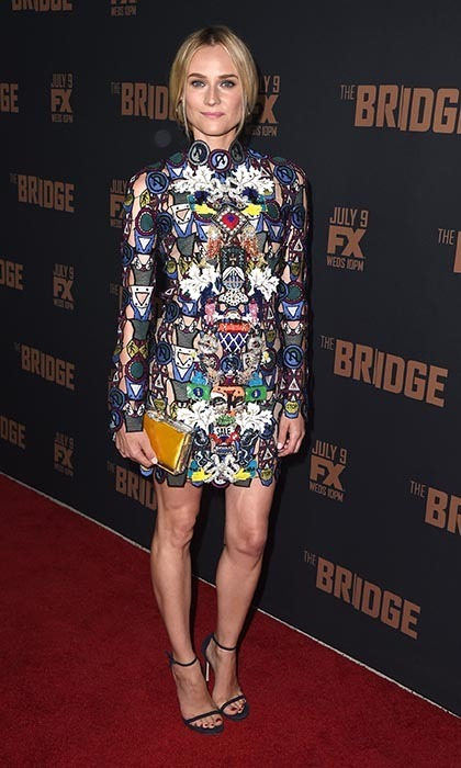 Diane Kruger made an appearance at the FX premiere of 'The Bridge' wearing an embroidered, multi-patterned number by Mary Katrantzou, the famed Stuart Weitzman Nudist sandals, Charlotte Olympia's Pandora clutch and gunmetal hoop earrings.