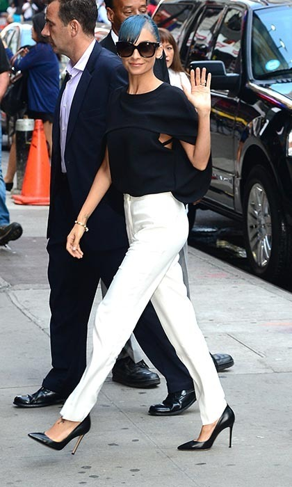 Nicole Richie made her way through New York City in Balenciaga's Cady cape top, white Viktor & Rolf trousers, classic Gianvito Rossi pumps and jewelry from her own House of Harlow 1960 line.