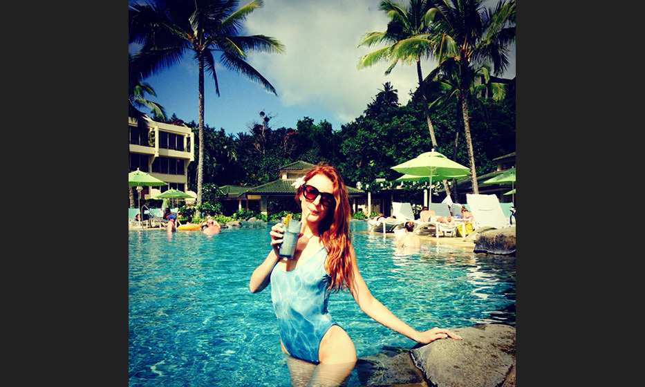 Sipping on my 10th coco-jito at the St. Regis Princeville. Pool-camo bathing suit by Clashist (http://clashist.myshopify.com/collections/swim/products/pool-water-swimsuit)