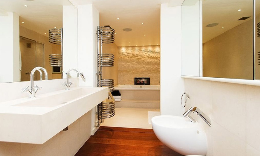 His and hers sinks complement this spacious and clean bathroom.