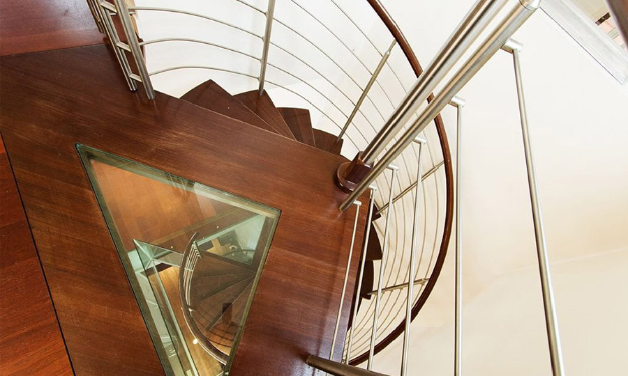 A gorgeous spiral staircase is one of the more intriguing focal points.