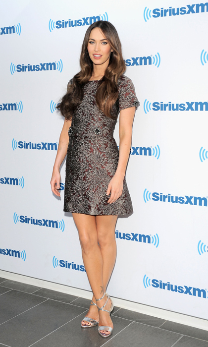 Megan Fox made an appearance at the SiriusXFM Studios wearing a jacquard number by Dolce & Gabbana with crystal embellishments at the sleeves and waist and Brian Atwood's metallic 'Tamara' sandals. (Image: Getty)