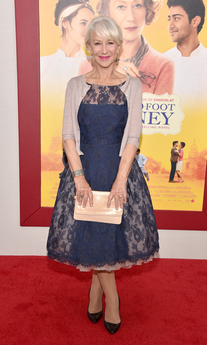 Dame Helen Mirren looked positively radiant in a navy lace-paneled dress and beige cardigan at 'The Hundred-Foot Journey' in New York. (Image: Getty)