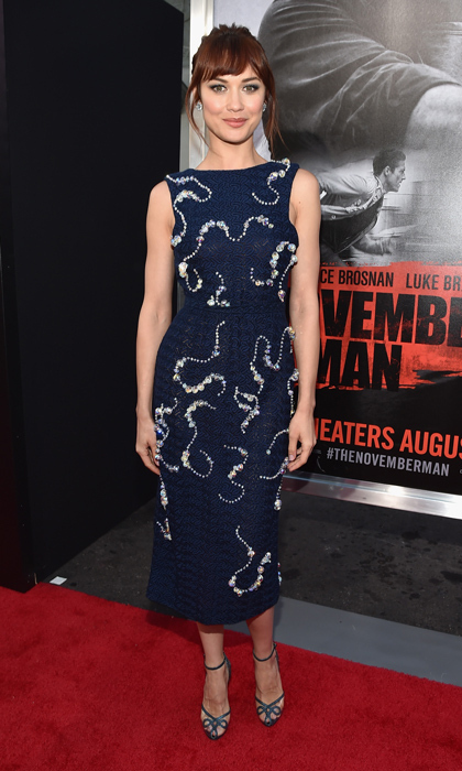 Olga Kurylenko stunned at the L.A. premiere of 'The November Man' in a wool pencil dress by Michael van der Ham that shone with crystal embellishments, and completed her look with vintage ankle-strap heels and oversized diamond earrings. (Photo: © Getty)