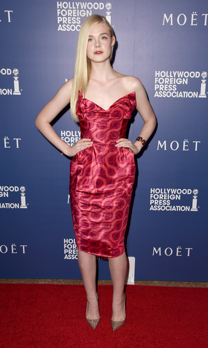 Elle Fanning proved she's a master of a high fashion in a corseted frock from Vivienne Westwood's Gold Label that featured an exaggerated sweetheart neckline and bold pattern. She perfectly accented the dress with sparkling rose-gold Christian Louboutin pumps. (Photo: © Getty)