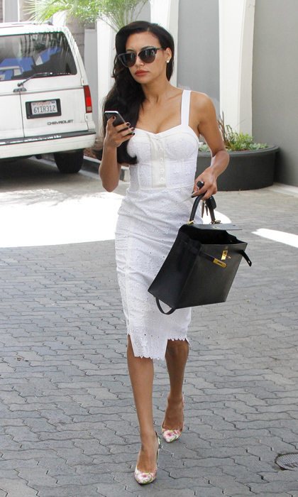 Out and about in Beverly Hills, newly married Naya Rivera Dorsey took her cue from Old Hollywood in a little white dress from Rebecca Minkoff, Hermes 'Kelly' bag and rose-printed Stuart Weitzman pumps. (Photo: © Getty)