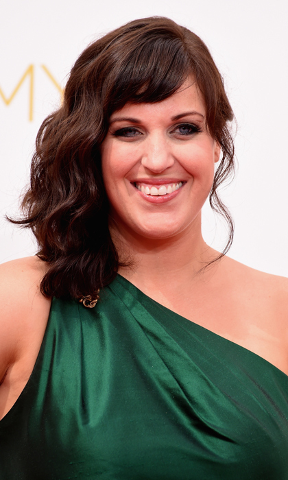 Allison Tolman of 'Fargo' escaped the cold and complimented her one-shoulder emerald gown with a nude lip (barren pouts were everywhere on the red carpet!) and side-swept hair. © Getty
