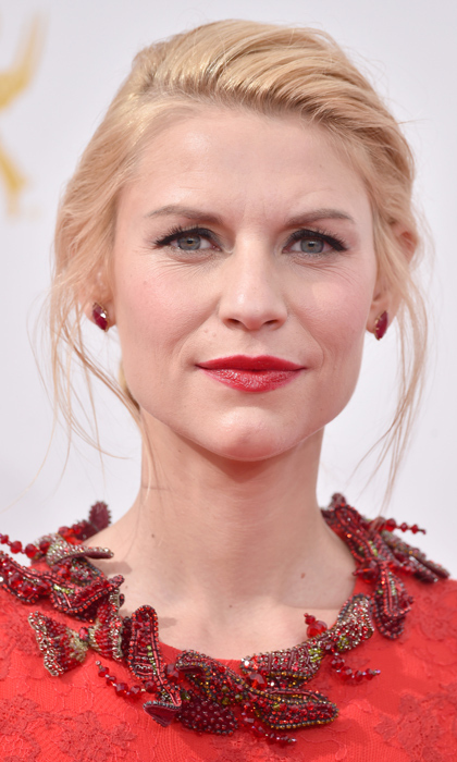 Carrie Mathison may not care much about her hair and makeup, but unlike her 'Homeland' character, Claire Danes knows how to turn on the glamour with a wispy updo, smokey eyes and a bold red lip. © Getty