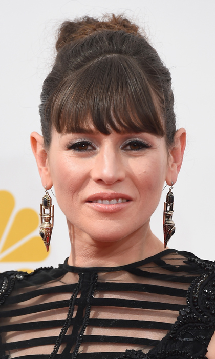 She's one of the most glamorous characters on 'Orange Is The New Black' (anyone who can curl their hair with tissues is lightyears ahead of us!), and Yael Stone doesn't fall far from Morello - though she traded her character's red pout for the night's popular nude lip. © Getty